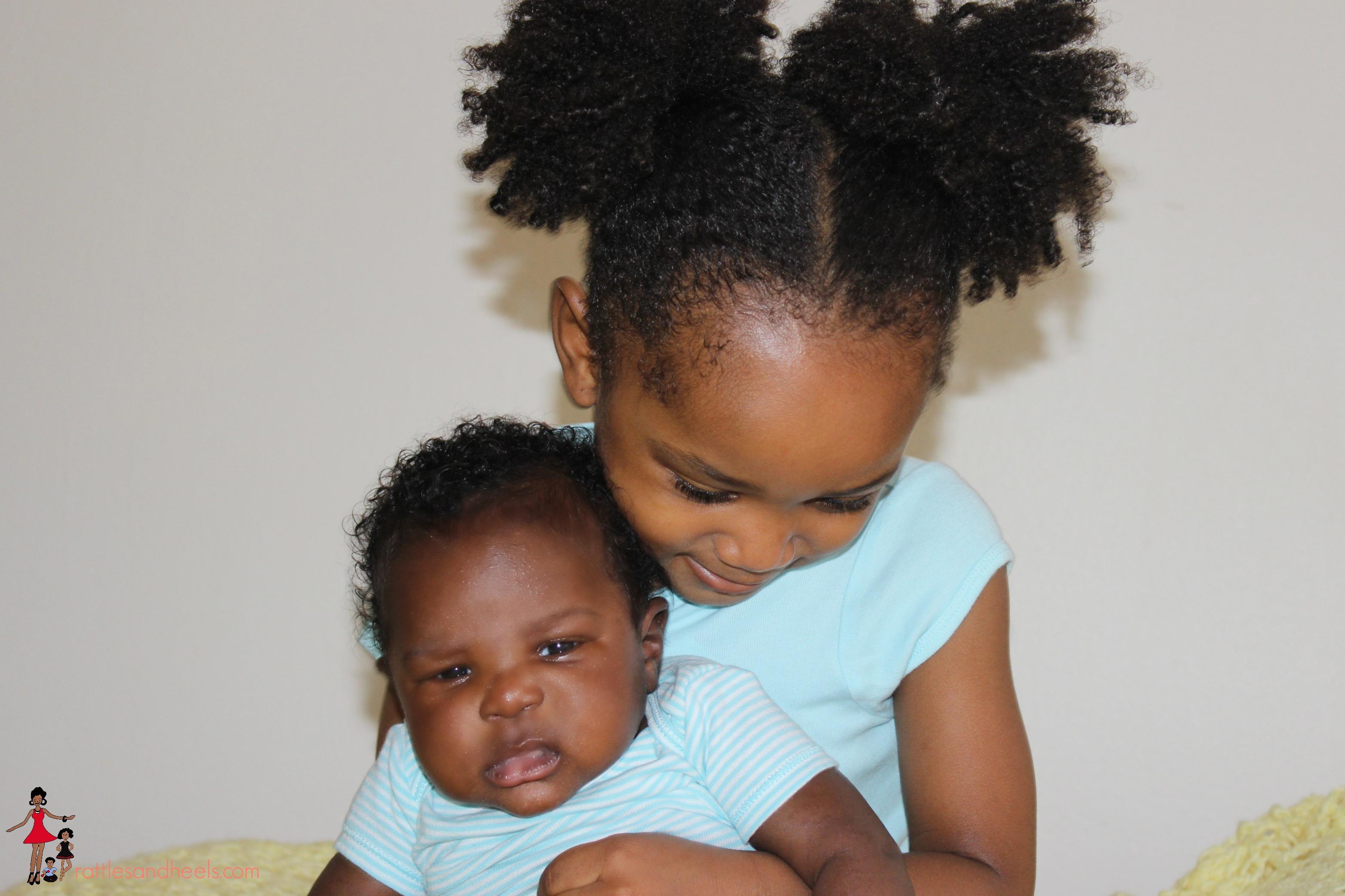 sibling-bonding-toddler-newborn