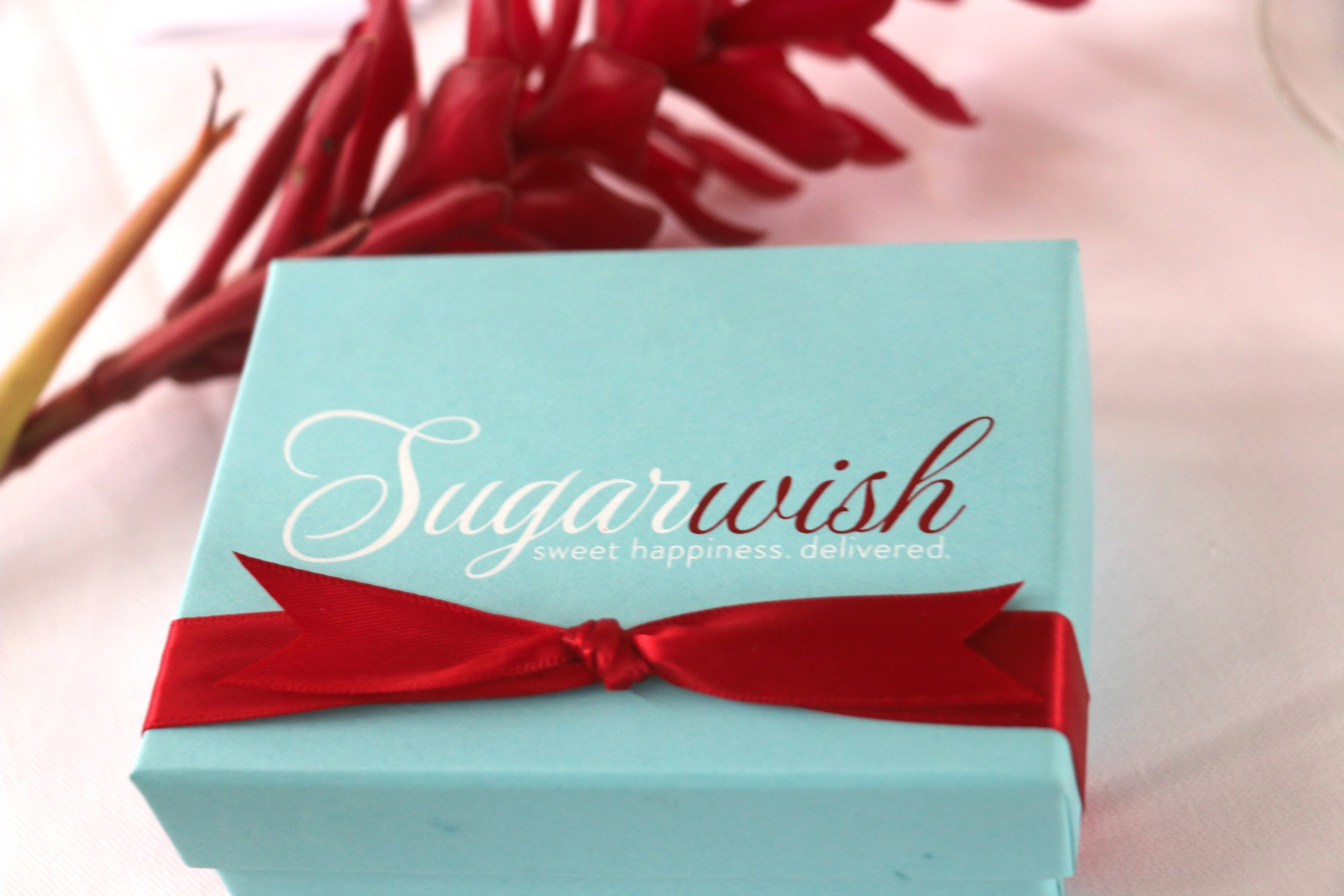This is the gift you can't open in front of the kids but will definitely be one of your favorites. I had the chance to discover Sugar Wish this fall and I absolutely love the concept and of course the candy. See we all need a little sweetness in our day ever so often so just imagine how sweet it would be to receive an email with a Sugar Wish eGift card. You get the chance to choose more