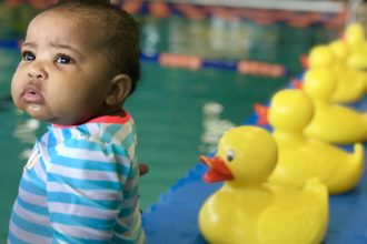 When to Enroll Your Baby in Swimming Lessons| rattles and heels