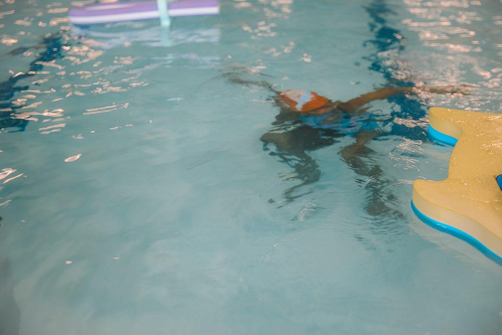 Kids swimming in the pool at Goldfish Swim School.